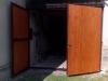 Křídlová vrata obložená dřevem