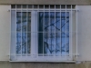 Okenní mříže v panelovém domě